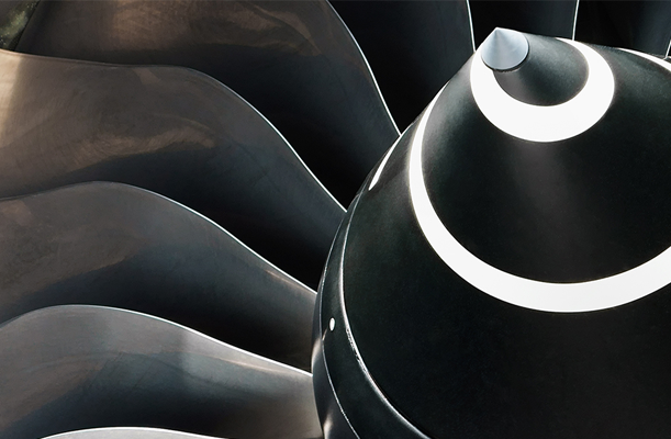 Close up of the nose cowl of a Rolls Royce jet engine turbine intake.