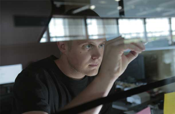 Man Analyzing Information on a Glass Screen